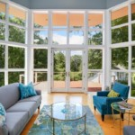 Living room surrounded by glass. Outdoor allergens not far from coming inside your home to create indoor allergies