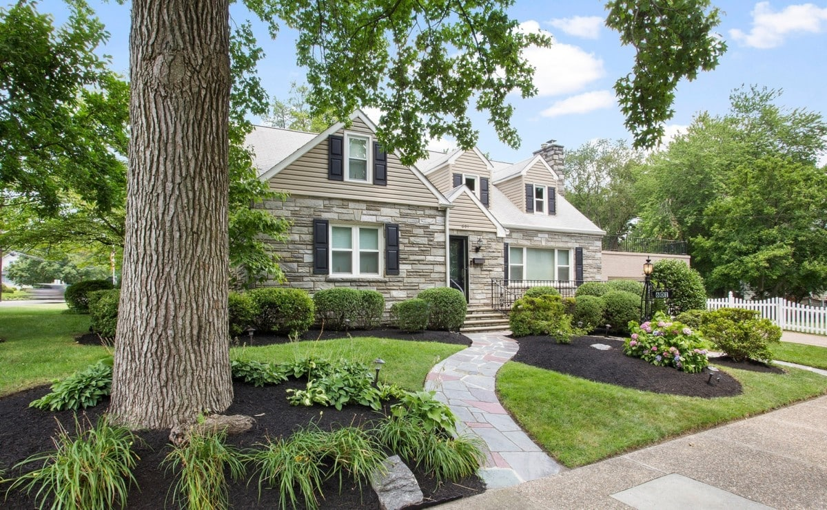 brick house curb appeal lush landscaping