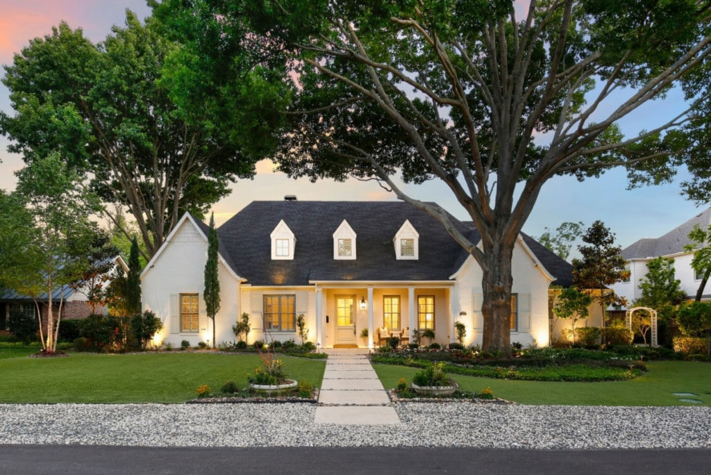 A single-story white home sold with a listing agent
